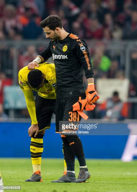 Manuel Akanji and goal keeper Roman Buerki of Borussia Dortmund after the final whistle during the Bundesliga match between FC Bayern Muenchen and...