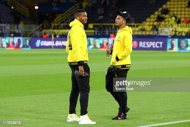 Manuel Akanji and Jadon Sancho of Borussia Dortmund walk on the pitch prior to the UEFA Champions League group F match between Borussia Dortmund and...