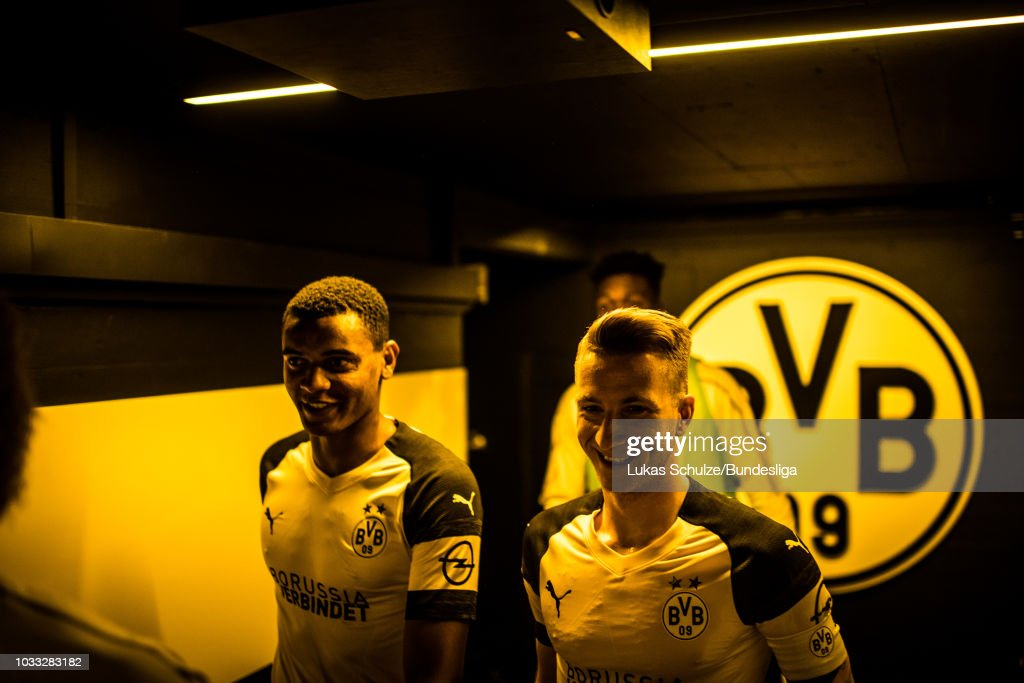 Manuel Akanji (L) and Marco Reus (R) of Dortmund are focused in the players tunnel prior to the Bundesliga match between Borussia Dortmund and Eintracht Frankfurt at Signal Iduna Park on September 14, 2018 in Dortmund, Germany.
