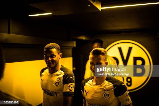 Manuel Akanji and Marco Reus of Dortmund are focused in the players tunnel prior to the Bundesliga match between Borussia Dortmund and Eintracht...