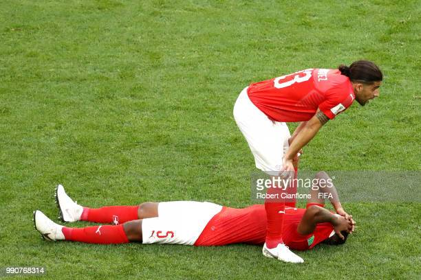 Manuel Akanji and Ricardo Rodriguez of Switzerland look dejected following the 2018 FIFA World Cup Russia Round of 16 match between Sweden and...
