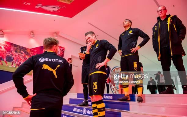 Manuel Akanji Lukasz Piszczek and Marcel Schmelzer of Borussia Dortmund prior to the Bundesliga match between FC Bayern Muenchen and Borussia...
