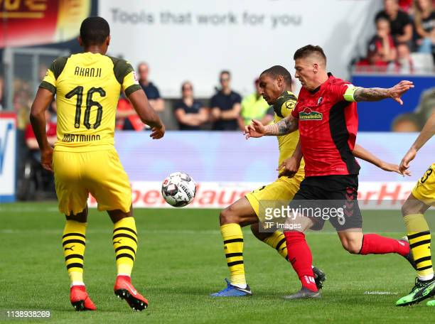 Manuel Akanji of Borussia Dortmund Abdou Diallo of Borussia Dortmund and Mike Frantz of SportClub Freiburg battle for the ball during the Bundesliga...