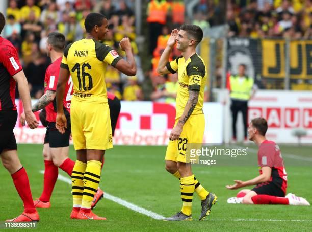 Manuel Akanji of Borussia Dortmund and Christian Pulisic of Borussia Dortmund celebrate after their team's fourth goal during the Bundesliga match...