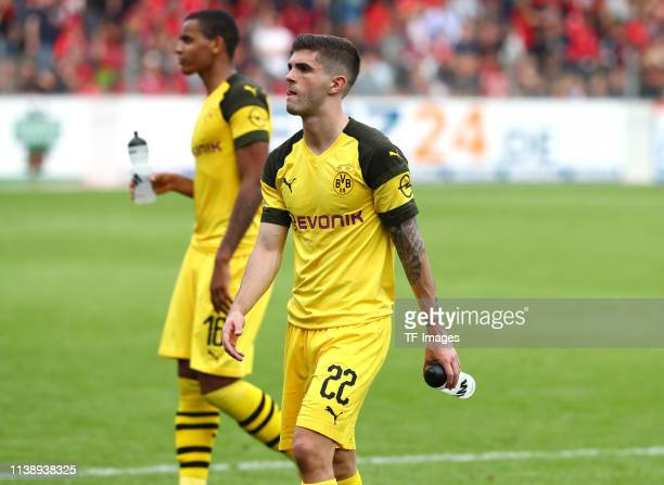 Manuel Akanji of Borussia Dortmund and Christian Pulisic of Borussia Dortmund celebrate after winning the Bundesliga match between SportClub Freiburg...
