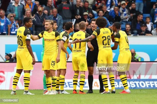 Manuel Akanji of Borussia Dortmund and Marcel Schmelzer of Borussia Dortmund Goalkeeper Roman Buerki of Borussia Dortmund Thomas Delaney of Borussia...
