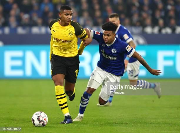 Manuel Akanji of Borussia Dortmund and Weston McKennie of FC Schalke 04 battle for the ball during the Bundesliga match between FC Schalke 04 and...