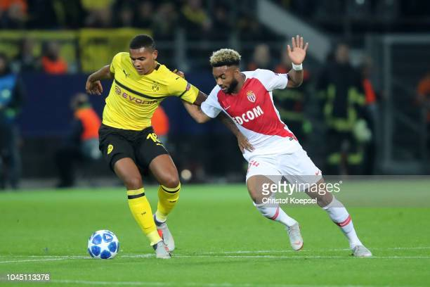 Manuel Akanji of Borussia Dortmund battles for possession with Moussa Sylla of Monaco during the Group A match of the UEFA Champions League between...