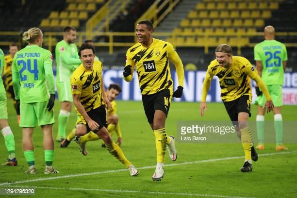 Manuel Akanji of Borussia Dortmund celebrates after scoring their sides first goal during the Bundesliga match between Borussia Dortmund and VfL...