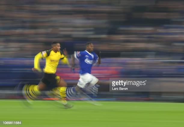 Manuel Akanji of Borussia Dortmund chases down Hamza Mendyl of FC Schalke 04 during the Bundesliga match between FC Schalke 04 and Borussia Dortmund...