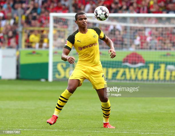 Manuel Akanji of Borussia Dortmund controls the ball during the Bundesliga match between SportClub Freiburg and Borussia Dortmund at...