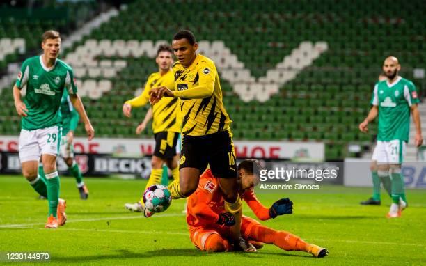 Manuel Akanji of Borussia Dortmund gets fouled during the Bundesliga match between SV Werder Bremen and Borussia Dortmund at the Wohninvest...
