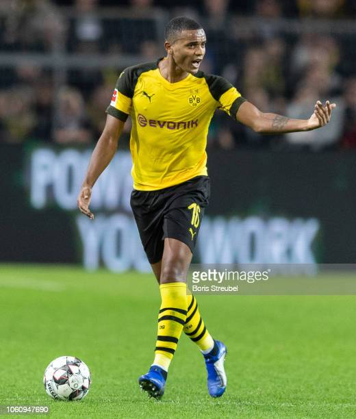Manuel Akanji of Borussia Dortmund runs with the ball during the Bundesliga match between Borussia Dortmund and FC Bayern Muenchen at Signal Iduna...