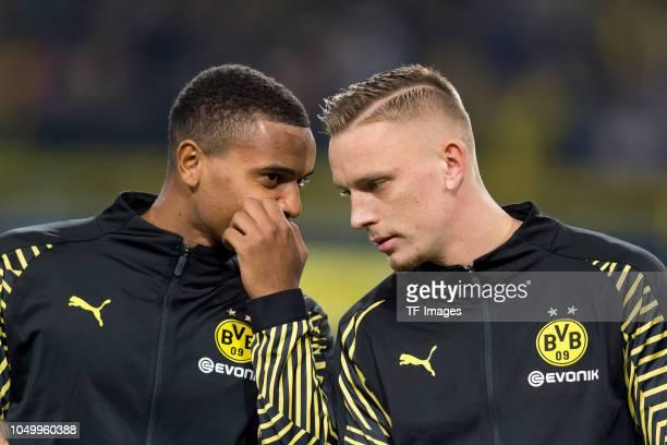 Manuel Akanji of Borussia Dortmund speak with Marius Wolf of Borussia Dortmund during the Group A match of the UEFA Champions League between Borussia...