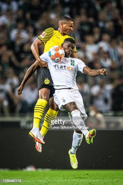 Manuel Akanji of Dortmund and Breel Embolo of Mönchengladbach in action during the Bundesliga match between Borussia Mönchengladbach and Borussia...