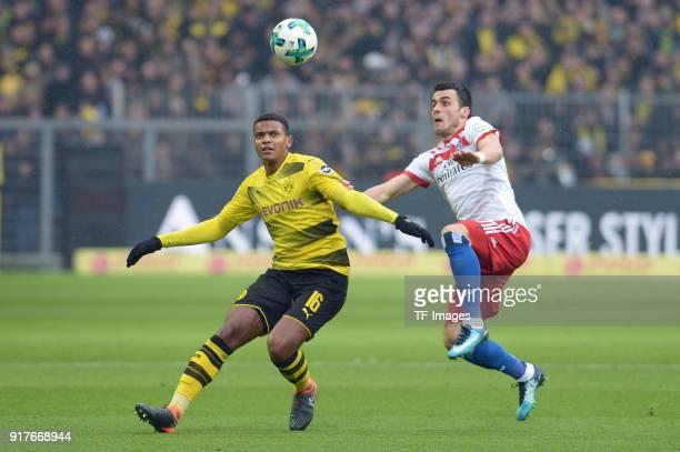 Manuel Akanji of Dortmund and Filip Kostic of Hamburg battle for the ball during the Bundesliga match between Borussia Dortmund and Hamburger SV at...