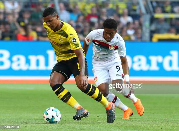 Manuel Akanji of Dortmund and Leon Bailey of Leverkusen battle for the ball during the Bundesliga match between Borussia Dortmund and Bayer 04...