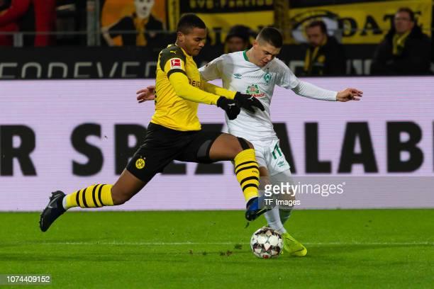 Manuel Akanji of Dortmund and Milot Rashica of Werder Bremen battle for the ball during the Bundesliga match between Borussia Dortmund and SV Werder...