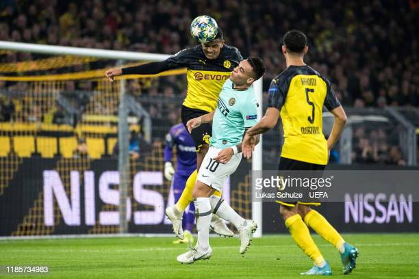 Manuel Akanji of Dortmund battles for possession with Lautaro Martinez of Inter during the UEFA Champions League group F match between Borussia...