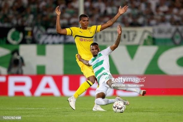 Manuel Akanji of Dortmund battles for the ball with Daniel KaitaRuel of Fuerth during the DFB Cup first round match between SpVgg Greuther Fuerth and...