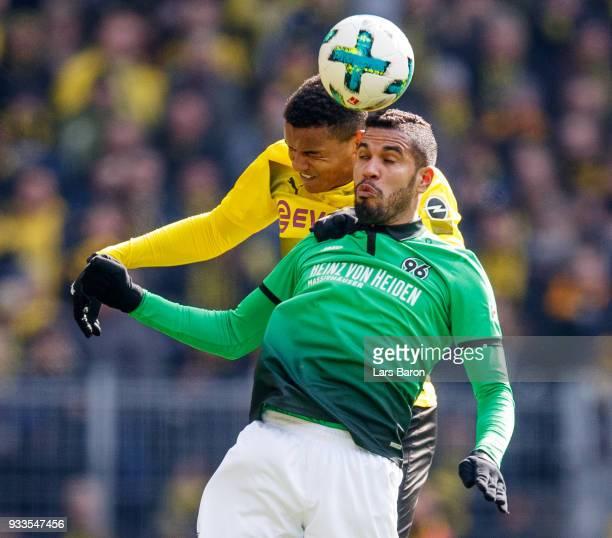 Manuel Akanji of Dortmund goes up for a header with Jonathas of Hannover during the Bundesliga match between Borussia Dortmund and Hannover 96 at...