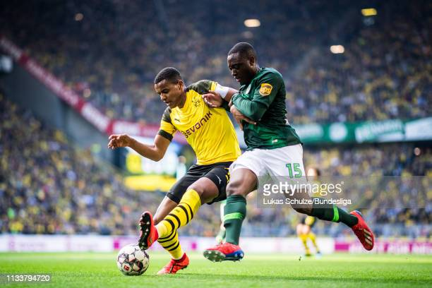 Manuel Akanji of Dortmund in action against Jerome Roussillon of Wolfsburg during the Bundesliga match between Borussia Dortmund and VfL Wolfsburg at...