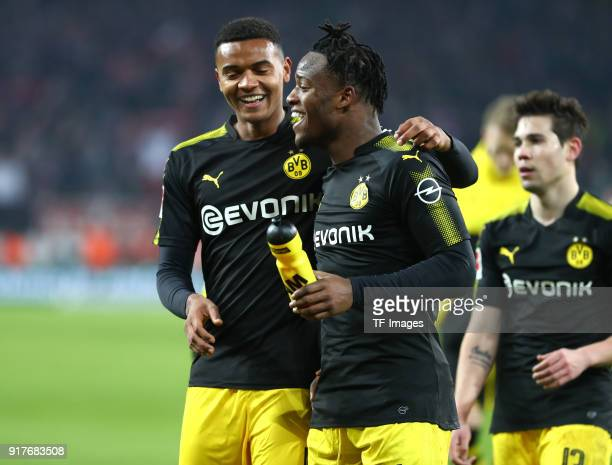 Manuel Akanji of Dortmund Michy Batshuayi of Dortmund and Raphael Guerreiro of Dortmund celebrate after winning the Bundesliga match between 1 FC...