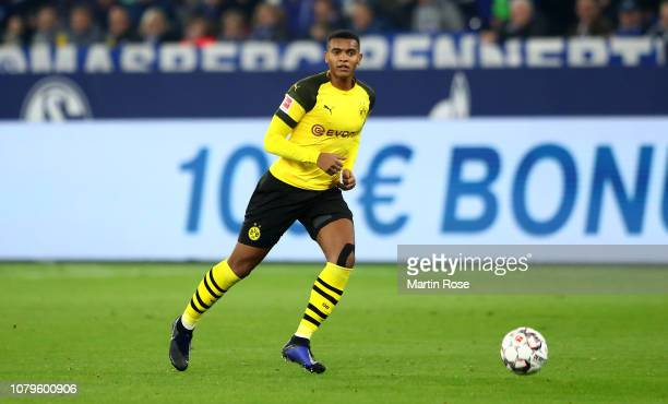 Manuel Akanji of Dortmund runs with the ball during the Bundesliga match between FC Schalke 04 and Borussia Dortmund at VeltinsArena on December 08...