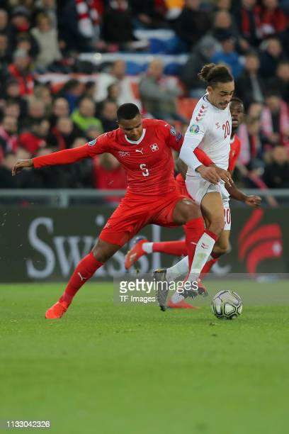 Manuel Akanji of Switzerland and Yussuf Poulsen of Denmark battle for the ball during the 2020 UEFA European Championships group D qualifying match...