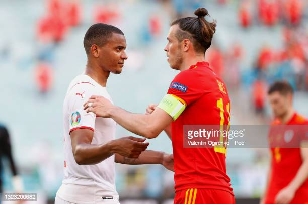 Manuel Akanji of Switzerland interacts with Gareth Bale of Wales following the UEFA Euro 2020 Championship Group A match between Wales and...