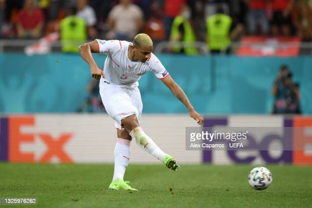 Manuel Akanji of Switzerland scores their team's third penalty in a penalty shoot out during the UEFA Euro 2020 Championship Round of 16 match...