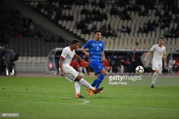 STADIUM ATHENS ATTIKI GREECE Manuel Akanji of Switzerland shots the ball way in front of Lazaros Christodoulopoulos of Greece Switzerland won against...