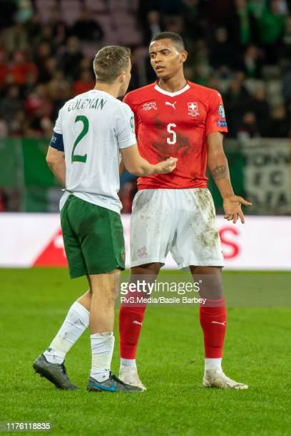 Manuel Akanji of Switzerland talks with Seamus Coleman of Republic of Ireland during the UEFA Euro 2020 qualifier between Switzerland and Republic of...