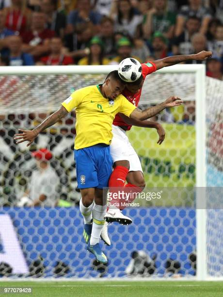 Manuel Akanji of Switzerland wins a header over Gabriel Jesus during the 2018 FIFA World Cup Russia group E match between Brazil and Switzerland at...