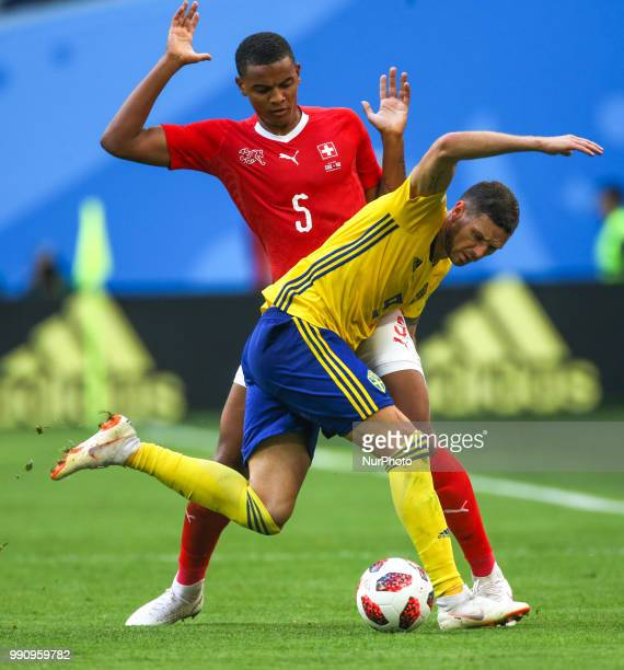 Manuel Akanji of the Switzerland national football team and Marcus Berg of the Sweden national football team vie for the ball during the 2018 FIFA...