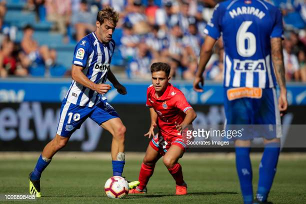 Manuel Alejandro Garcia of Deportivo Alaves CF Oscar Melendo Jimenez of RCD Espanyol during the La Liga Santander match between Deportivo Alaves v...