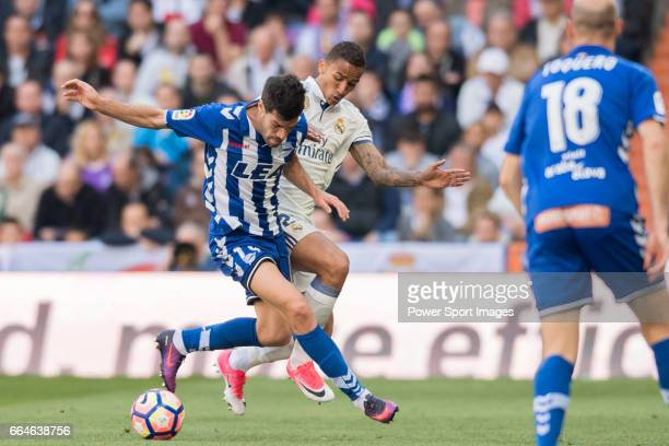 Manuel Alejandro Garcia Sanchez of Deportivo Alaves battles for the ball with Danilo Luiz Da Silva of Real Madrid during their La Liga match between...