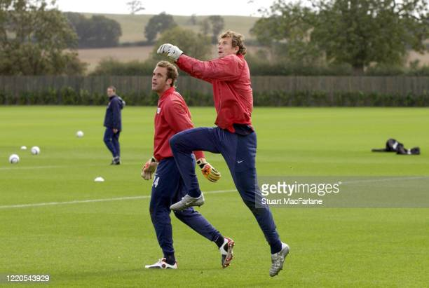 Manuel Almunia and Jens Lehmann of Arsenal during an Arsenal training session on September 21, 2004 in St. Albans, England.