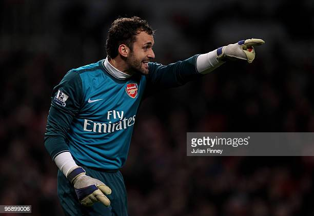 Manuel Almunia, goalkeeper of Arsenal, gives instructions during the Barclays Premier League match between Arsenal and Bolton Wanderers at The...