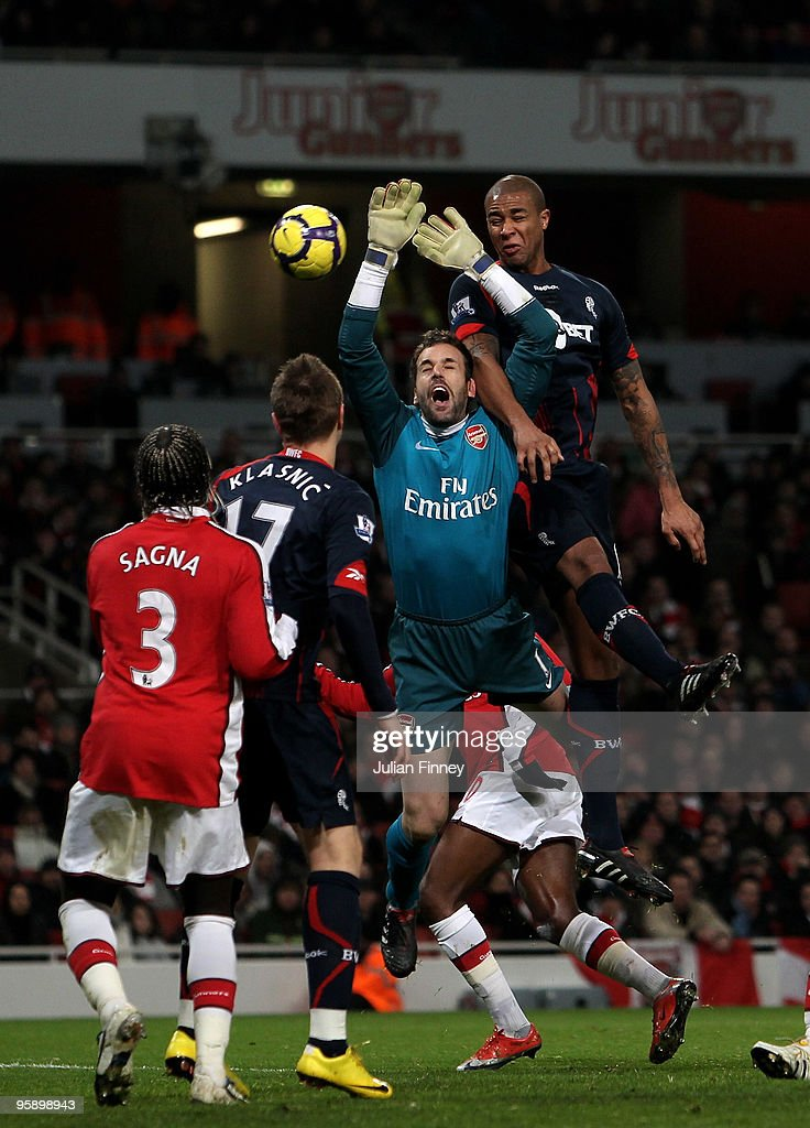 Manuel Almunia, goalkeeper of Arsenal, is fouled by Zat Knight of Bolton during the Barclays Premier League match between Arsenal and Bolton Wanderers at The Emirates Stadium on January 20, 2010 in London, England.