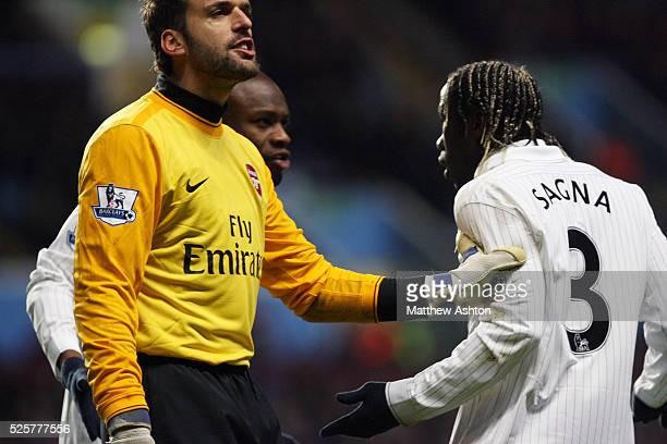 Manuel Almunia of Arsenal holds back Bacary Sagna of Arsenal as he appears to have a disagreement with William Gallas of Arsenal