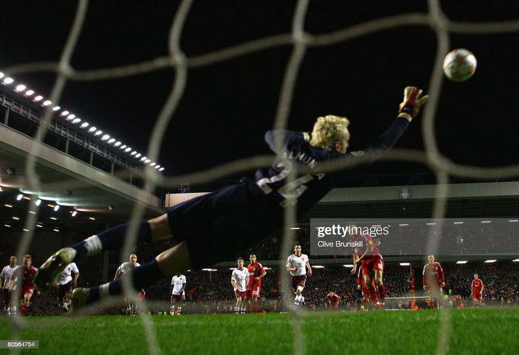 Manuel Almunia of Arsenal is unable to stop Steven Gerrard of Liverpool scoring his team's third goal from the penalty spot during the UEFA Champions League Quarter Final, second leg match between Liverpool and Arsenal at Anfield on April 8, 2008 in Liverpool, England.