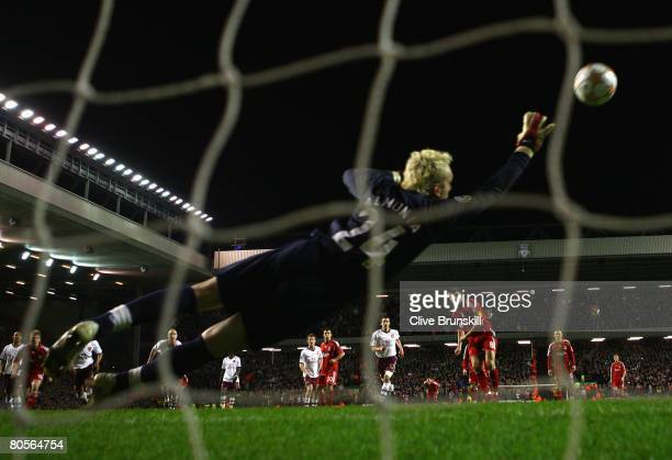 Manuel Almunia of Arsenal is unable to stop Steven Gerrard of Liverpool scoring his team's third goal from the penalty spot during the UEFA Champions...