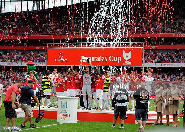 Manuel Almunia of Arsenal lifts the Emirates Cup trophy