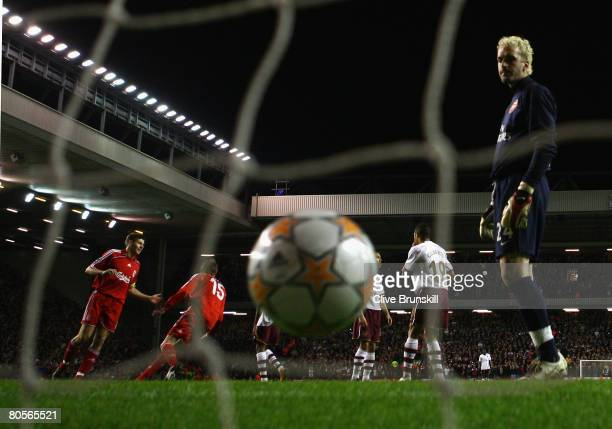 Manuel Almunia of Arsenal looks dejectedly at the ball after Fernando Torres of Liverpool scored his team's second goal during the UEFA Champions...