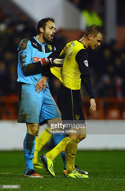 Manuel Almunia of Watford argues with Lars Joel Ekstrand during the Sky Bet Championship match between Nottingham Forest and Watford at City Ground...