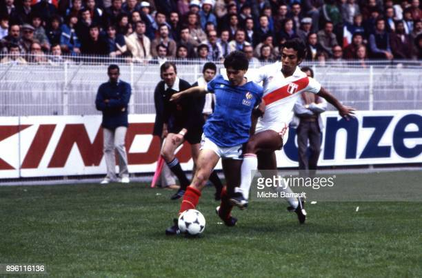 Manuel Amoros of France and Miguel Angel Gutierrez of Peru during the International Friendly match between France and Peru at Parc des Princes in...