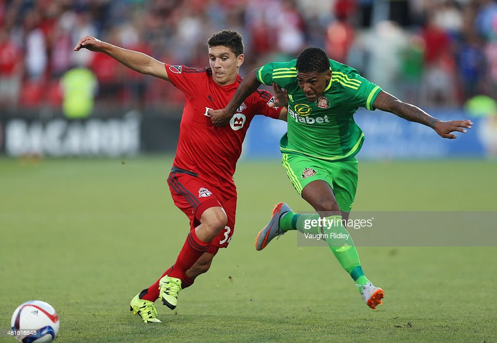 Manuel Aparicio #34 of Toronto FC and Patrick van Aanholt #3 of Sunderland AFC battle for the ball during a friendly match at BMO Field on July 22, 2015 in Toronto, Ontario, Canada.
