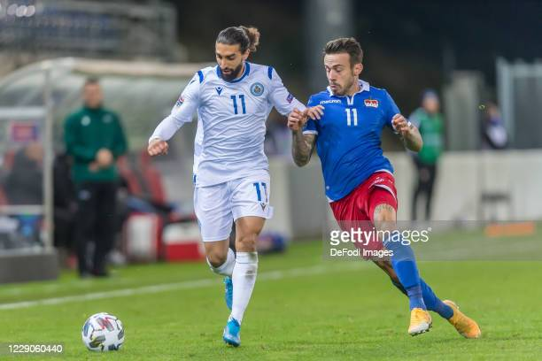 Manuel Battistini of San Marino and Dennis Slanovic of Liechtenstein battle for the ball during the UEFA Nations League group stage match between...