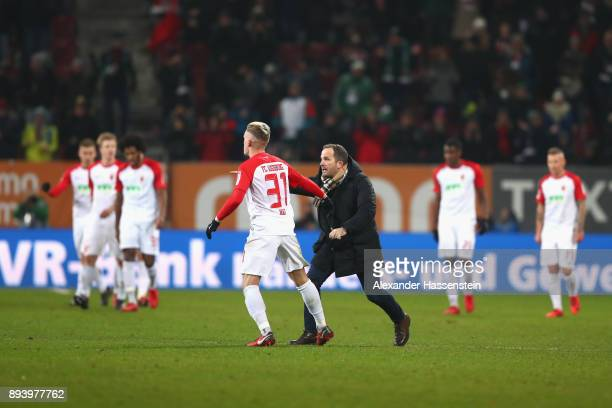 Manuel Baum head coach of Augsburg reacts after the 3rd team goal with his players during the Bundesliga match between FC Augsburg and SportClub...